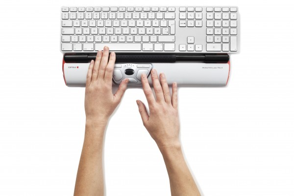 Contour_RollerMouse_Red_top_hands_keyboard_white_keys_300dpi